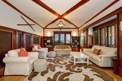 Authenic living room with brown and white decorative rug. Authenic living room with brown and white decorative rug, also including hardwood flor and white sofas Stock Image