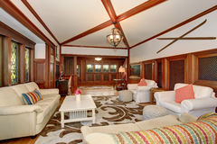 Authenic living room with brown and white decorative rug. Authenic living room with brown and white decorative rug, also including hardwood flor and white sofas Royalty Free Stock Image