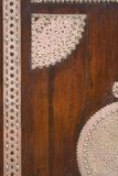 Wooden door with metal decorations Royalty Free Stock Images