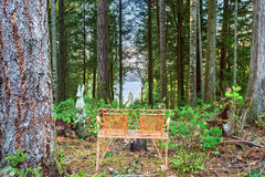 Authentic bench overlooking lake. Royalty Free Stock Photos