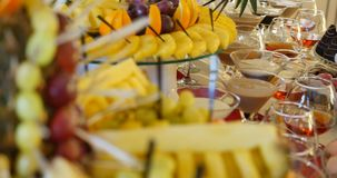Authentic buffet, assorted fresh fruits, berries and citrus fruits. Morning atmospheric lighting, fashionable trendy spot soft focus. Preparation for design stock video footage