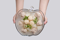 Chinese soups - scallops pork balls  turnip soup. An authentic Chinese pork meatball and turnip soup Royalty Free Stock Photos