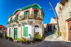 Authentic colorful mediterranean street in the village of Arsos. Limassol District, Cyprus royalty free stock image