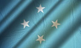 Authentic colorful flag of Micronesia. Authentic colorful textile flag of Micronesia Stock Photos