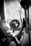 Authentic construction worker. Construction worker  at work with wooden  roof construction Royalty Free Stock Photography