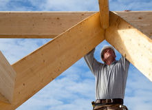 Carpenter roof. Builder at work with wooden  roof construction Royalty Free Stock Photo