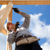 Authentic construction worker. Builder at work with measuring construction Royalty Free Stock Images