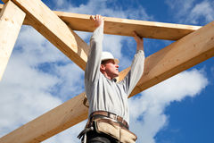 Carpenter roof. Carpenter at work with wooden  roof construction Royalty Free Stock Images