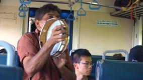 Authentic Cuture. Man Playing Tambourine in Train, Sri Lanka - 10 February 2017 stock footage