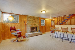 Authentic downstairs bar room with fireplace. Stock Photos
