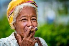 Free Authentic Elderly Cuban Woman Smoking Cigar. Beautiful Senior Woman Enjoying Cigar, Santiago De Cuba Royalty Free Stock Photography - 170845247