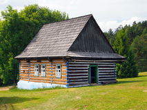 An authentic folk house in Stara Lubovna. A summertime view of an authentic folk house, located in the state-owned skansen of Stara Lubovna, in the Spis region royalty free stock image