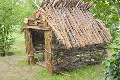 Authentic hut from the branches of the forest, summer Sunny day.  Stock Photo