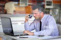 Authentic image of a businessman drinking coffee Royalty Free Stock Image