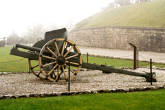 Authentic Italian cannon on a white foggy background  and a pebble pavement located in the city of Valli del Pasubio, Italy from Stock Photography
