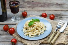 Authentic Italian lunch. Pasta and red wine. royalty free stock photography