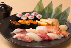 Authentic Japanese sushi with fresh raw fish. Traditional Japanese sushi with various fresh raw fish and miso soup Stock Image