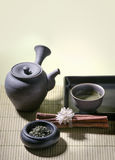 Authentic japanese tea pot with green tea. And cinnamon Royalty Free Stock Image
