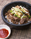 Authentic Korean Bulgogi bibimbap. Korean meal bulgogi bibimbap topped with zucchini, broccoli, green onions and carrots Royalty Free Stock Photos