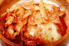 Authentic Korean Kimchi. Close-up of Korean Kimchi in wooden bowl Royalty Free Stock Image