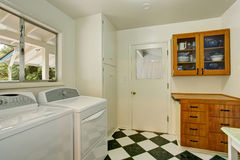 Authentic laundry room with checkered tile floor. Stock Photography