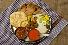 Authentic Maharashtrian lunch thali with Amras and poli, India. Authentic Maharashtrian lunch thali with Amras and poli, India stock image