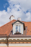 Authentic mansard window in a old style tiled roof Stock Images