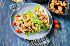 Authentic mexican tacos with chicken and salsa with avocado, tomatoes and chillies royalty free stock photography