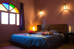 Authentic Moroccan bedroom in traditional riad Stock Photography