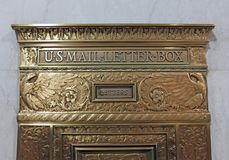 Authentic old-fashioned U.S. Mail Letter Box in marble wall. This old-fashioned U.S. Mail letter box is a fully functional mail drop for out-going mail. There is stock photography