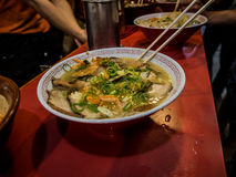 Authentic Osaka Ramen in a busy street side restaurant. A delicious bowel of authentic Ramen noodles in a roadside Osaka restaurant. Full of noodles, pork and Royalty Free Stock Photos