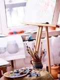 Authentic paint brushes still life on table in art class school. royalty free stock photos