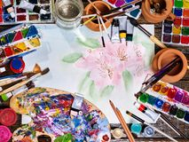 Authentic paint brushes still life on table in art class school. Authentic paint brushes still life in art class school. Group of brush in clay jar. Bouquet of royalty free stock photography