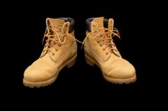 Authentic pair of 8 inch Yellow Work Boots. Isolated on black Stock Images