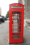 Authentic red English phone booth Royalty Free Stock Images