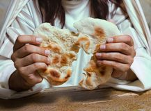 Breaking holy bread. Authentic reenactment scene of Jesus breaking the bread during Last Supper, saying `this is my body royalty free stock photography