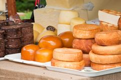 Authentic Romanian cheese varieties. Traditional Romanian cheese varieties displayed by a farmer at a medieval fair Stock Image