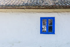 Authentic Romanian village house  built with natural bio materials and ancient techniques in traditional architecture. Closeup on. Blue painted window frame and Stock Images