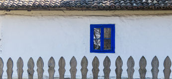 Authentic Romanian village house  built with natural bio materials and ancient techniques in traditional architecture. Closeup on. Blue painted window frame and Stock Image