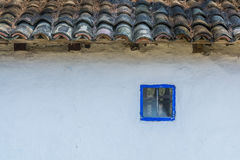 Authentic Romanian village house  built with natural bio materials and ancient techniques in traditional architecture. Closeup on. Blue painted window frame and Royalty Free Stock Photography