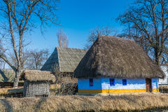 Authentic Romanian village house covered with straws and built with natural bio materials in traditional architecture Royalty Free Stock Photo