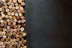 Authentic, rustic corks and black copy space. An assortment of authentic, rustic wine bottle corks beside empty black copy space Stock Photography