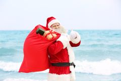 Authentic Santa Claus with big red bag full of gifts Stock Photography