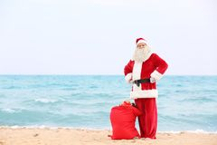 Authentic Santa Claus with big red bag full of gifts Royalty Free Stock Photo