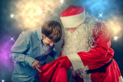 Authentic Santa Claus brought gifts. Stock Photography