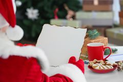 Authentic Santa Claus with letter. At table Royalty Free Stock Photography