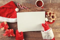 Authentic Santa Claus with letter. At wooden table Royalty Free Stock Photos