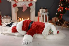 Authentic Santa Claus lying. On floor indoors royalty free stock images