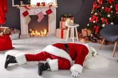 Authentic Santa Claus lying on floor. Indoors stock image