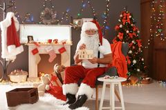 Authentic Santa Claus painting toy house Royalty Free Stock Images
